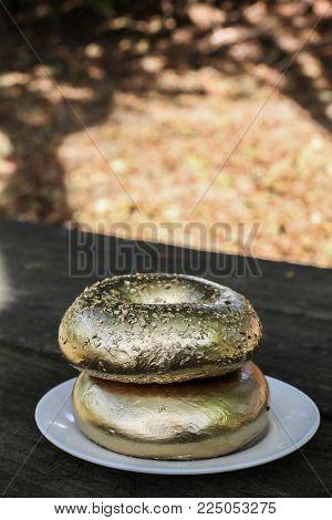 Golden bagels on table outside