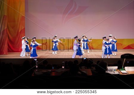 MOSCOW, RUSSIA - April 8, 2017: children in the form of military sailors are dancing waltz on stage