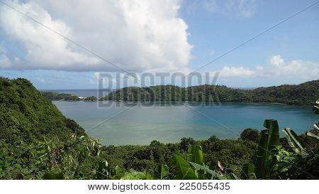 Seascape tropical island, lagoon, beach and hills.. Tropical landscape sky, clouds and mountains rocks with rainforest. Blue lagoon in the ocean. Travel concept.