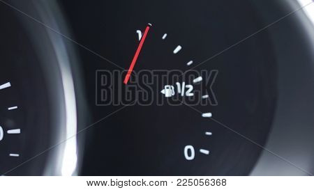 Close-up car dash board petrol meter, fuel gauge, with over full gasoline in car. Clip. Gasoline sensor.