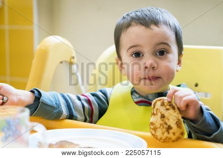 Boy 2 years old holding a picnic in his hand