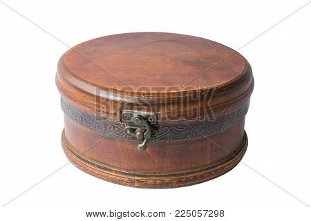 A vintage wooden dusty jewellery box on a white background, isolated