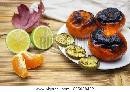 New Japanese superfood, grilled tangerines with the peel. A photo of the antioxidant grilled mandarine fruits, nuts and limes for longevity, long life. New convincing eastern superfoods