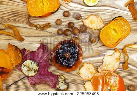 New Japanese superfood, grilled tangerines with the peel. An overhead photo of the antioxidant grilled mandarine fruits, nuts, limes for longevity, long life. New convincing eastern superfoods