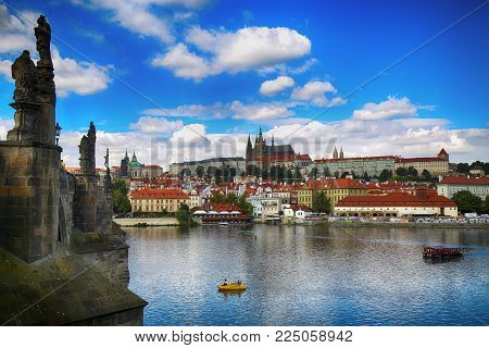 PRAGUE, CZECH REPUBLIC - AUGUST 23, 2016: Panoramic view on St. Vitus Cathedral from Charles Bridge with statues on the Bridge Karluv Most in Prague, Czech Republic