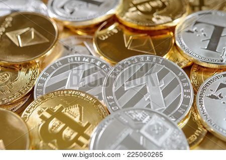 Mix of golden and silver bitcoins, litecoins and ethereum coins. Cryptocurrency concept. Real photo. Luxury background.