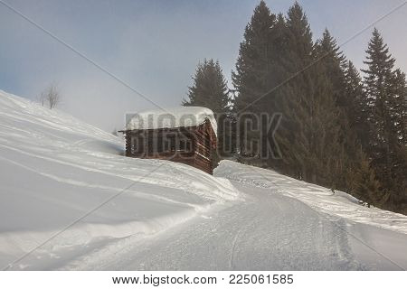 A lot of snow on the roof in the mountains