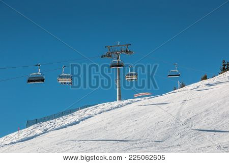 Ski lift and snow in the mountains