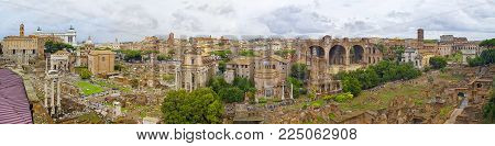 Wide panoramic view on old antique architecture ruins museum, the Colosseum of Rome. Old city Rome people tourists. People tourists walking in museum of Rome city antique architecture old town ruins