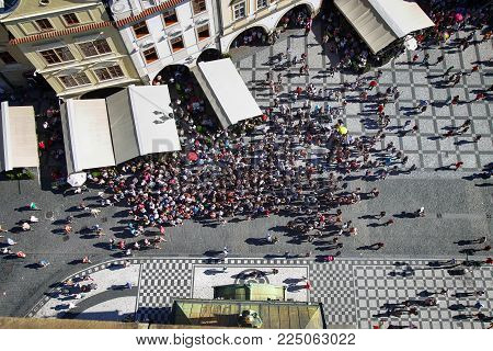PRAGUE, CZECH REPUBLIC - AUGUST 24, 2016: Aerial View of people visiting the Old Town Square from on top Old Town Hall tower in Prague, Czech Republic