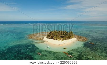 Aerial view of beautiful tropical island Guyam with white sand beach. View of a nice tropical beach from the air. Seascape: Ocean and beautiful beach paradise. Philippines. 4K video. Travel concept. Aerial footage.