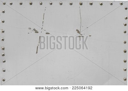 Gray backdrop. Metall with rivets. Background and texture.