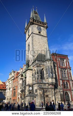 PRAGUE, CZECH REPUBLIC - AUGUST 23, 2016: People walking and look around The Prague old City Hall (clock tower), Old Town Square in Prague, Czech Republic