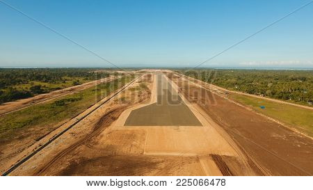 Construction of a new airport terminal on Panglao. Aerial view Modern airport terminal construction site. Construction of a landing strip on the island of Bohol, Philippines. Landing strip. Travel concept.