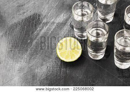 Cold Vodka In Shot Glasses On A Black Background