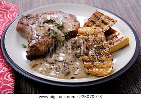 Seared Pork Chop, Mushroom Gravy With Zucchini, A Ketogenic Diet Meal