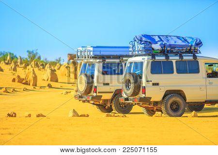 Cervantes, Australia - Dec 22, 2017: two Toyota Land Cruiser 4x4 along Pinnacles Drive, a dirt road in Pinnacles Desert, Nambung National Park, Western Australia.Discovery and adventure travel concept