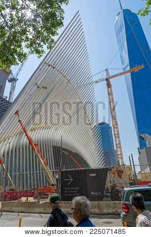 New York, USA - June 08, 2015: Ground Zero with the World Trade Center One and Transportation building late in the day in Lower Manhattan.