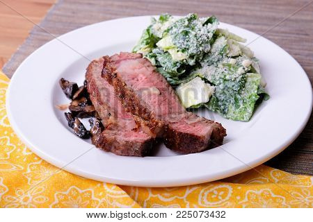 rib steak with side caesar salad, a ketogenic diet meal