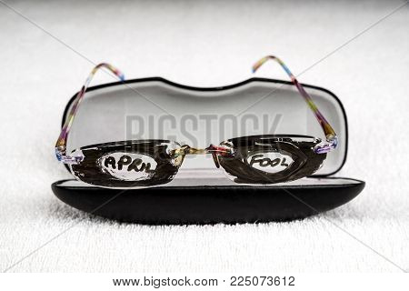 April Fool's day trick. Glasses that have had the lenses covered with pen and April Fool written on.