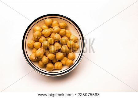 Closeup of a Bowl of Cooked Garbanzo Beans on a white background