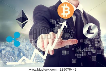Cryptocurrency concept with businessman above the city