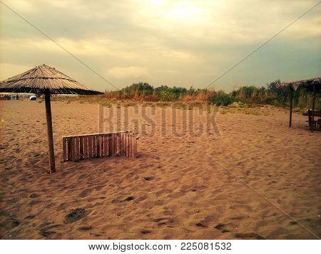 Beautiful Beach. Sand, Sky And Parasol. Ada Bojana, Montenegro