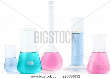 Chemical laboratory beakers with colorful liquids and reagents. Research science and medical laboratory.