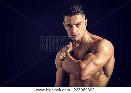 Good Looking Young Gym Fit Man Showing His Sexy Six Pack Abs While Looking at the Camera. on White Background.