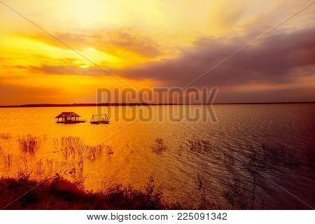 Winter river. Winter landscape. Sunset on the river. River. Horizon. Sun