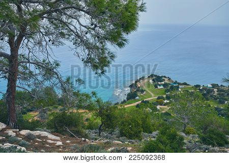 Looking across a campsite towards Chrysohou Bay, Laatchi, Polis and the Troodos Mountains, Akamas Peninsula, Paphos, Cyprus.