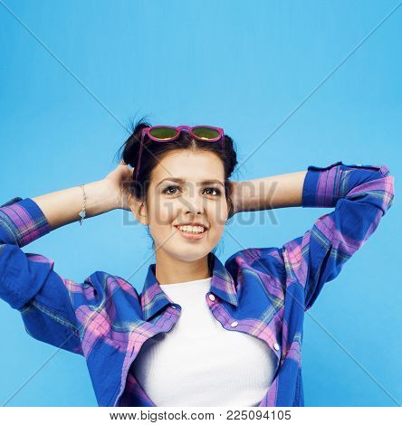 young pretty woman cheerful happy smiling, posing on blue background, lifestyle people concept close up