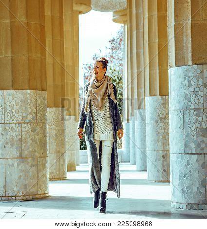 Happy Stylish Woman In Barcelona, Spain In Winter Walking