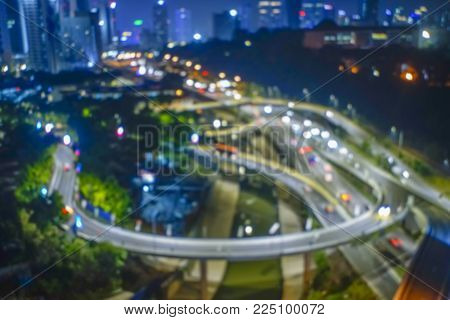 Blur Image Of Busy Highway In Big City At At Night.