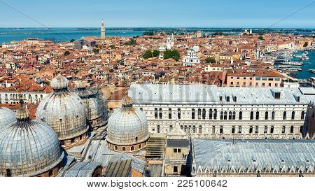 Aerial panoramic view of Venice, Italy. Domes of St Mark`s Basilica and Doge`s Palace in the foreground. Venice skyline.
