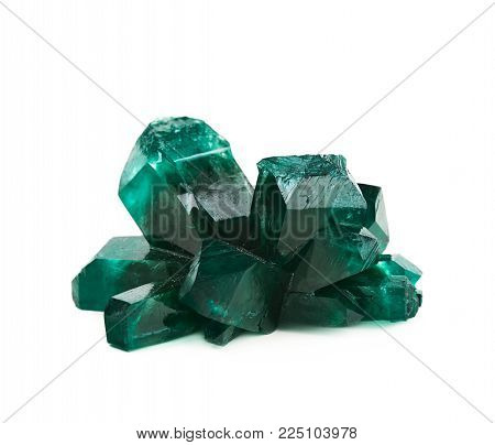 Grown crystal of green colored salt isolated over the white background