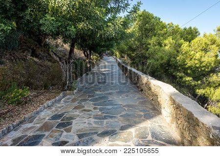 Stone Pathway Leading Up The Hill Overlooking Malaga, Spain, Europe