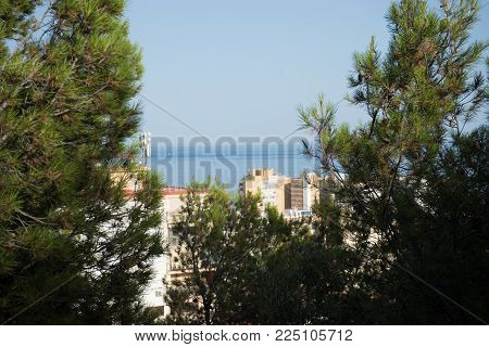 City Skyline Of Malaga Overlooking The Sea Ocean In Malaga, Spain, Europe
