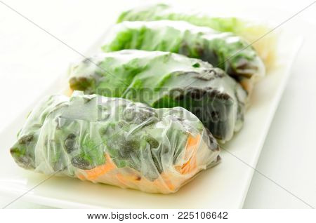 rice paper wrapped chicken with vermicelli noodles and a thai peanut sauce