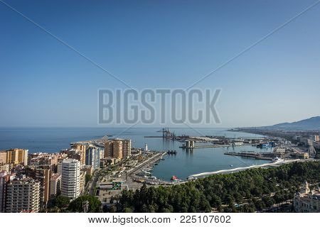 City Skyline And Harbour, Sea Port Of Malaga Overlooking The Sea Ocean In Malaga, Spain, Europe