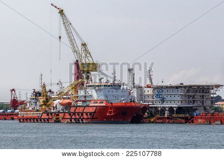 Labuan,Malaysia-Feb 2,2018:Offshore oil & gas sea construction & support vessels at port of Labuan,Malaysia. All the vessels port in Labuan island, most related to the offshore Oil & Gas industry.
