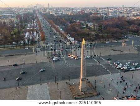 PARIS, FRANCE - CIRCA DECEMBER 2016: The Luxor Obelisk on Place de la Concorde and the Champs-Elysees aerial view from the ferris wheel at sunset.