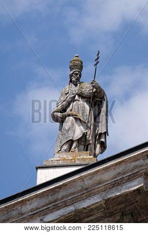MANTUA, ITALY - JUNE 04: Saint Pope Celestine, statue on facade of the Mantua Cathedral dedicated to Saint Peter, Mantua, Italy on June 04, 2017.