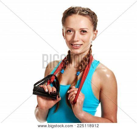 Portrait of beautiful smiling sportswoman holding elastic expander