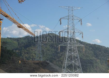 Electric power transmission line tower on the mountain