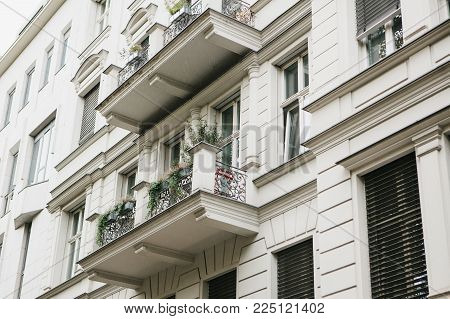 A Typical Apartment Building In Berlin With Balconies. Exterior Of A Multi-apartment City House.