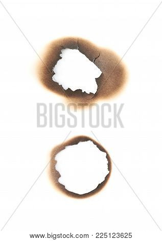 Round paper burn mark stained hole isolated over the white background , set of several different foreshortenings