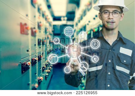 Industrial innovation technology and industry 4.0 concept. Double exposure of engineer man pointing finger with digital icon tools for deverlop business concept.