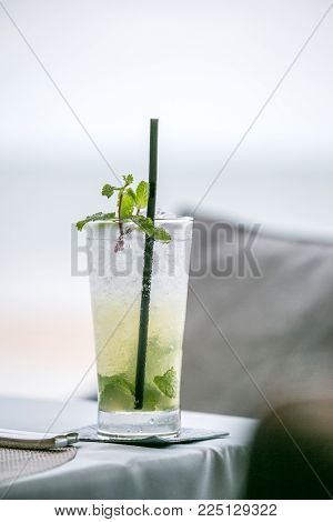 A glass of virgin mojito mocktail on the table
