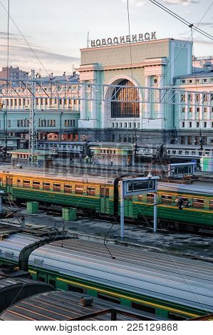 Novosibirsk, Russia - July 26, 2005: Railway station and trains in twilight